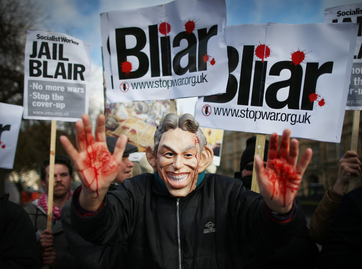 LONDON, ENGLAND - JANUARY 29: A Stop the War Coalition protester, wearing a mask depicting Former Prime Minister Tony Blair, shows bloodied hands near Parliament on January 29, 2015 in London, England. Members of Parliament are today debating delays to the official inquiry into the Iraq War. The Chilcot inquiry began in 2009 and says it will not release it's final report until after the general election. (Photo by Peter Macdiarmid/Getty Images)
